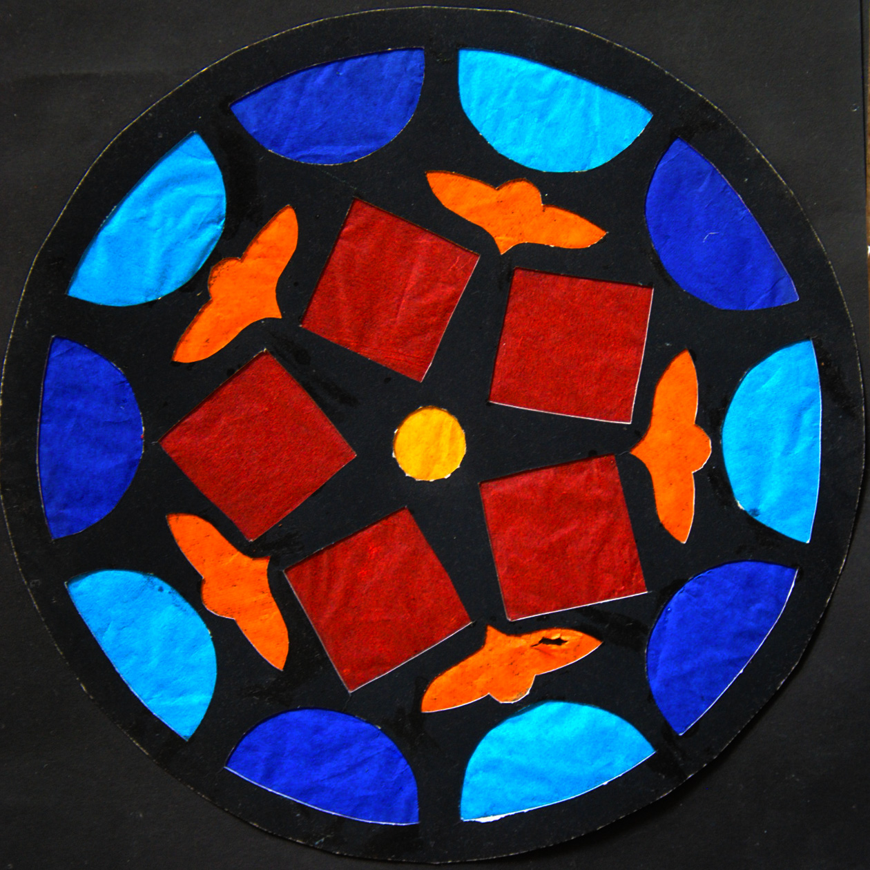 Create a stained glass rose window activity for Stained glass window craft with tissue paper