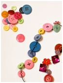In this first grade arts and crafts activity, you can make fun bracelets using just a handful of buttons and some elastic cord. And it's a counting game, too!